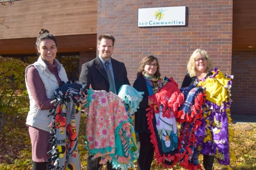 Employees deliver blankets to 360 Communities in Lakeville