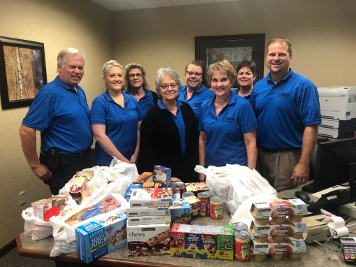 La Salle staff with food donations