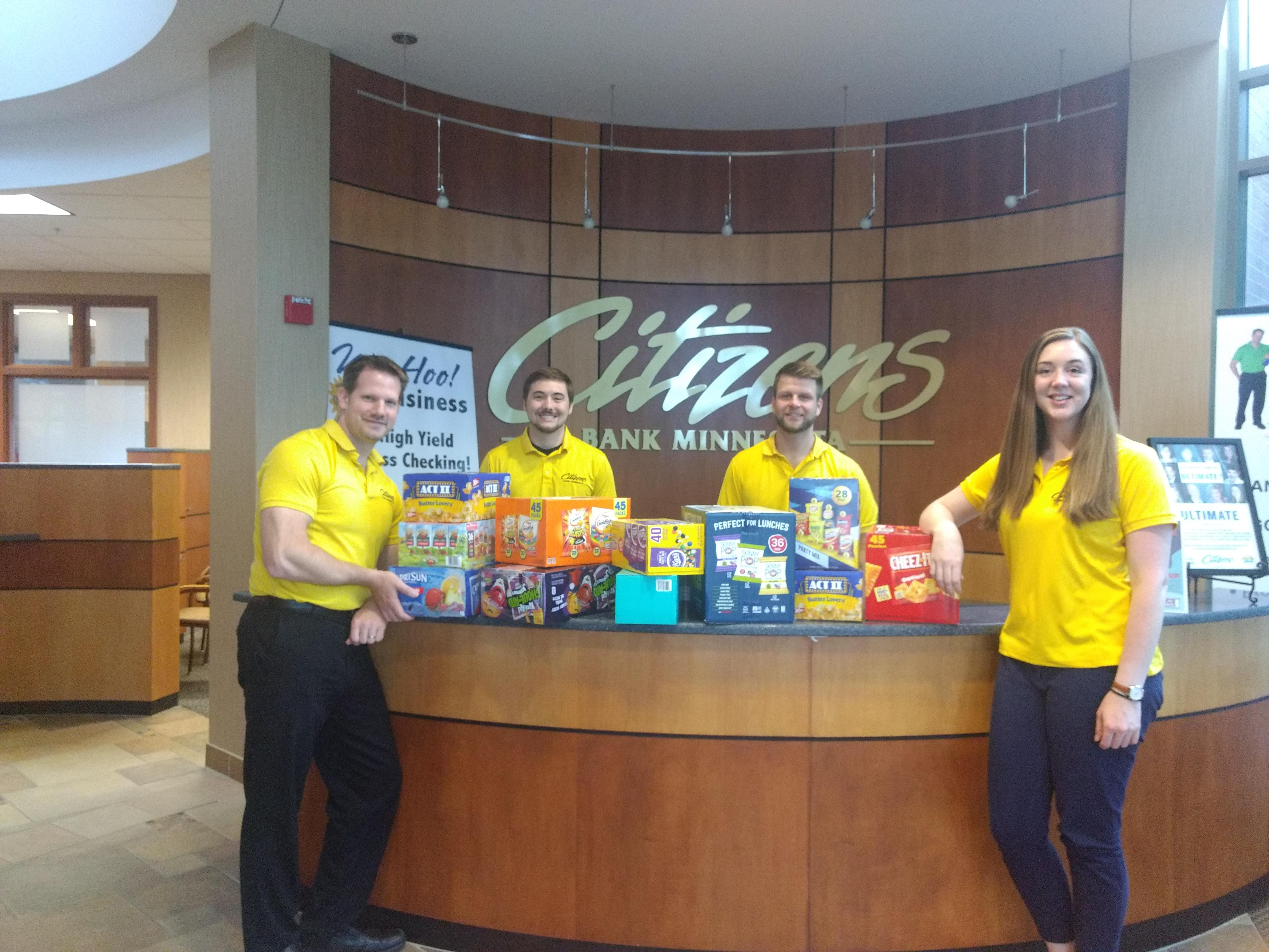 Lakeville staff with food donations